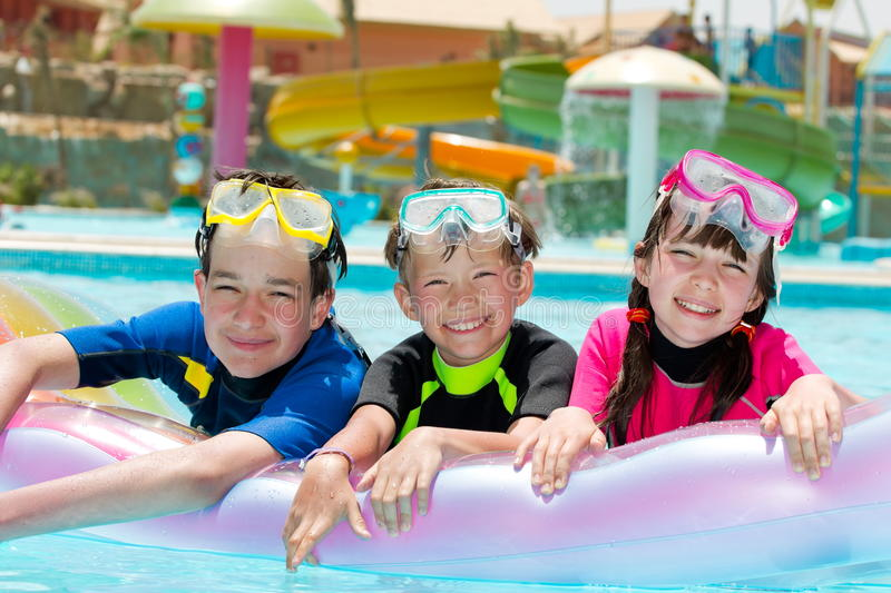 Kids in swimming pool stock photos