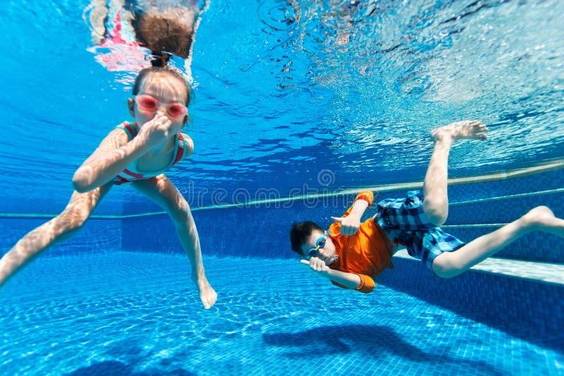 Kids swimming underwater royalty free stock photo