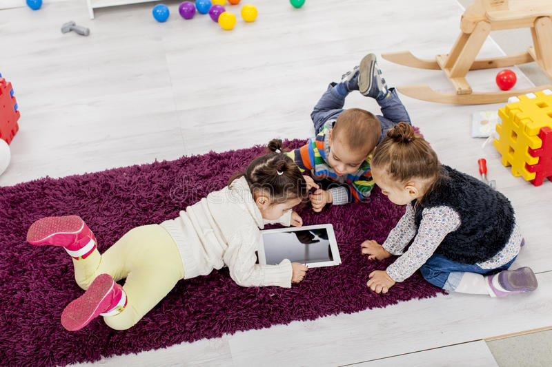 Download Kids with tablet stock image. Image of floor, daycare - 28688627