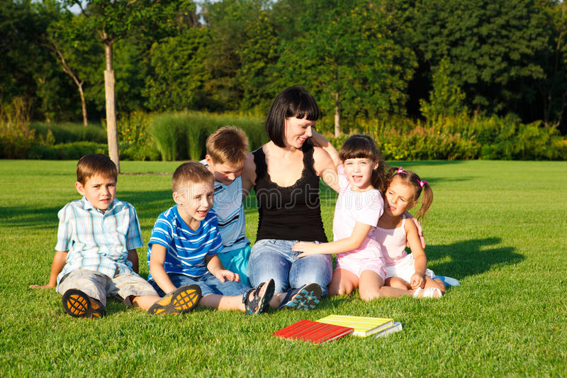 Kids with teacher stock photography