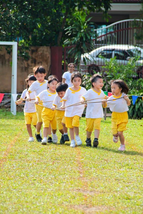 Kids teamwork racing stock photo
