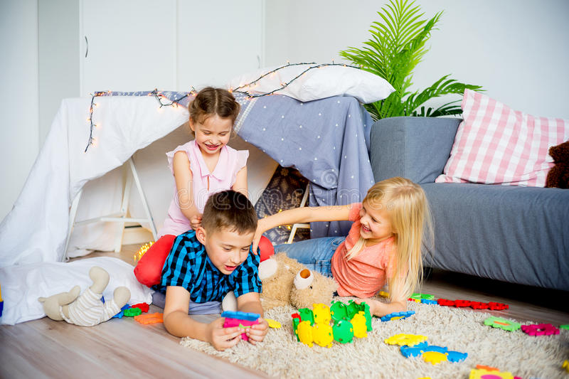 Kids in a teepee stock image