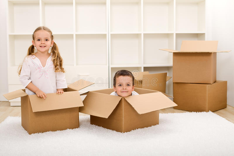 Download Kids In Their New Home With Boxes Royalty Free Stock Photography - Image: 13931517