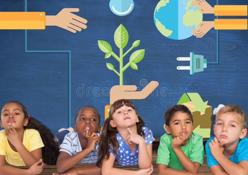 Kids thinking together and blue wall with recycling and renewable graphics. Digital composite of Kids thinking together and blue wall with recycling and royalty free stock photos