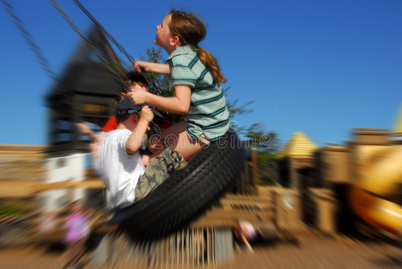 Download Kids on tire swing stock image. Image of happy, fast, children - 7118899