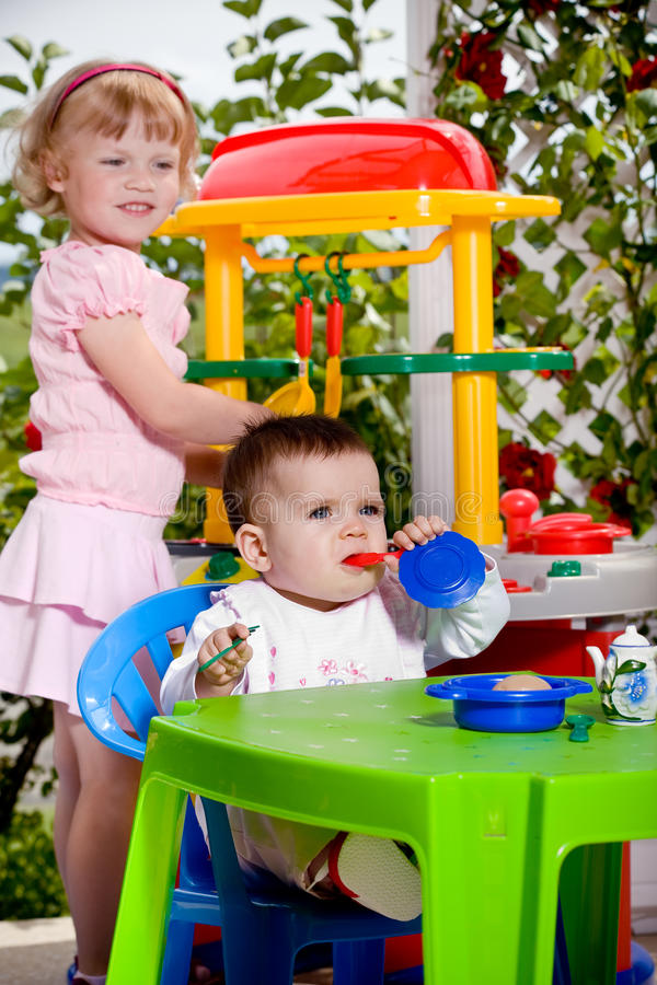 Kids and toy kitchen royalty free stock photos