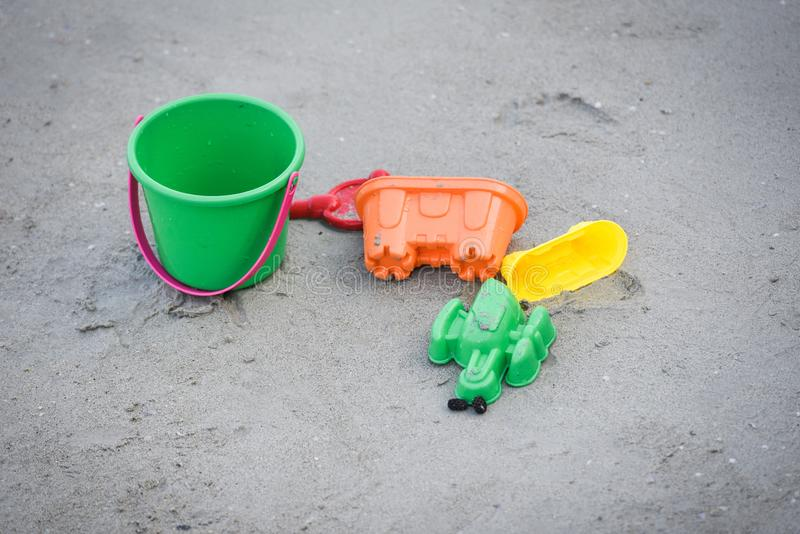 Kids toy on the sandy beach royalty free stock photography