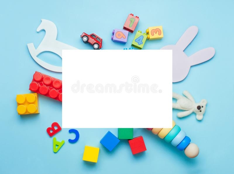 Kids toys on blue background with rectangle blank space royalty free stock photos