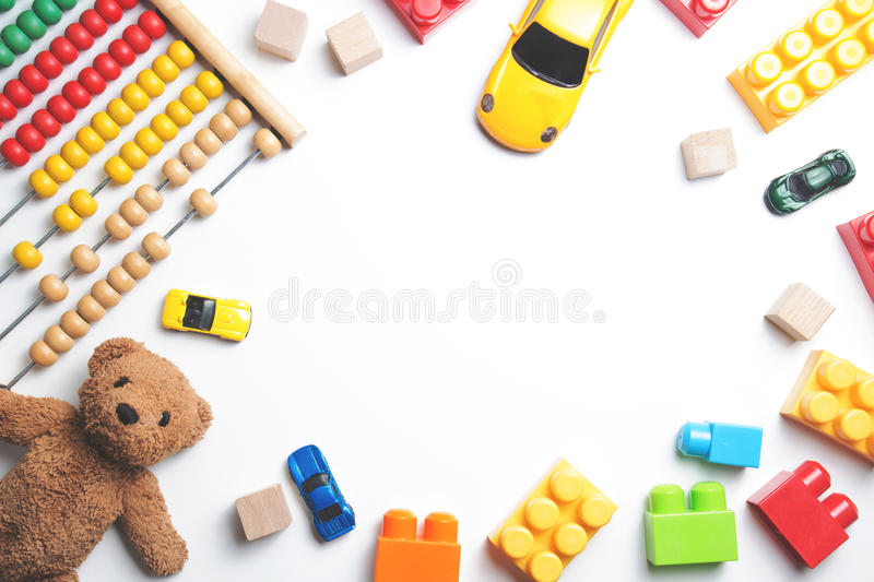 Kids toys frame on white background. Top view. Flat lay royalty free stock photo