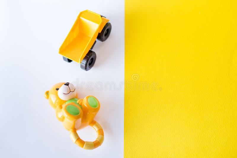 Kids toys on white and yellow background. Flat lay. Copy space for text. Kids toys on white and yellow background. Top view. Flat lay. Copy space for text royalty free stock photography