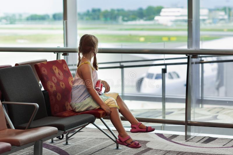 Kids travel and fly. Child at airplane in airport stock images