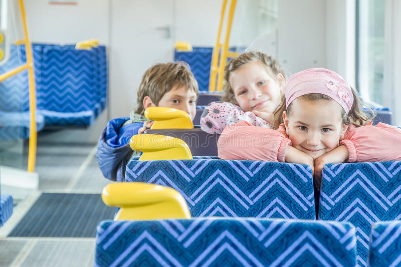 Kids travelling by train royalty free stock photography