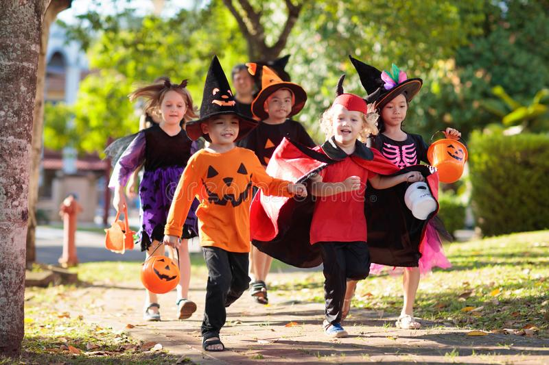 Kids trick or treat. Halloween fun for children stock photo