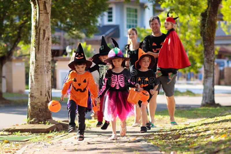 Kids trick or treat. Halloween fun for children stock photos