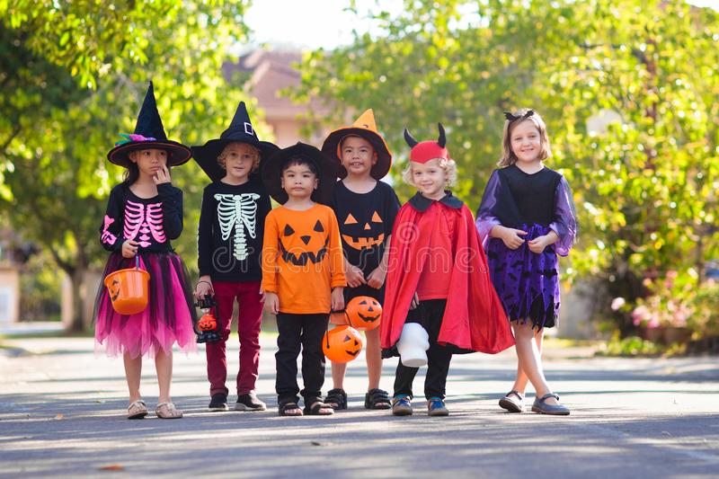 Kids trick or treat. Halloween fun for children royalty free stock photos