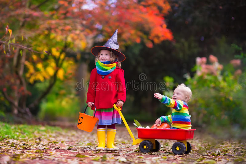 Kids trick or treat at Halloween stock images