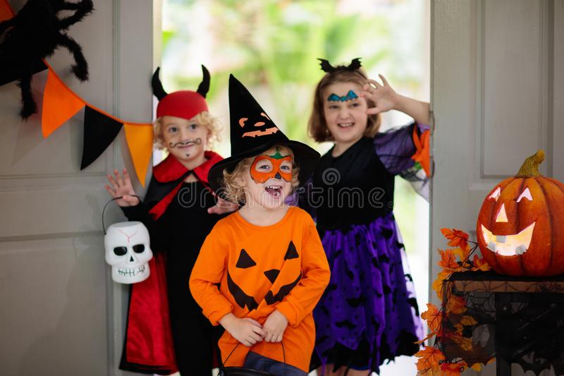 Kids trick or treat. Halloween. Child at door royalty free stock images