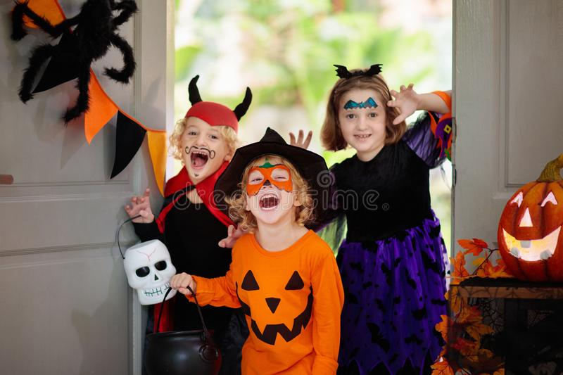 Kids trick or treat. Halloween. Child at door royalty free stock photos