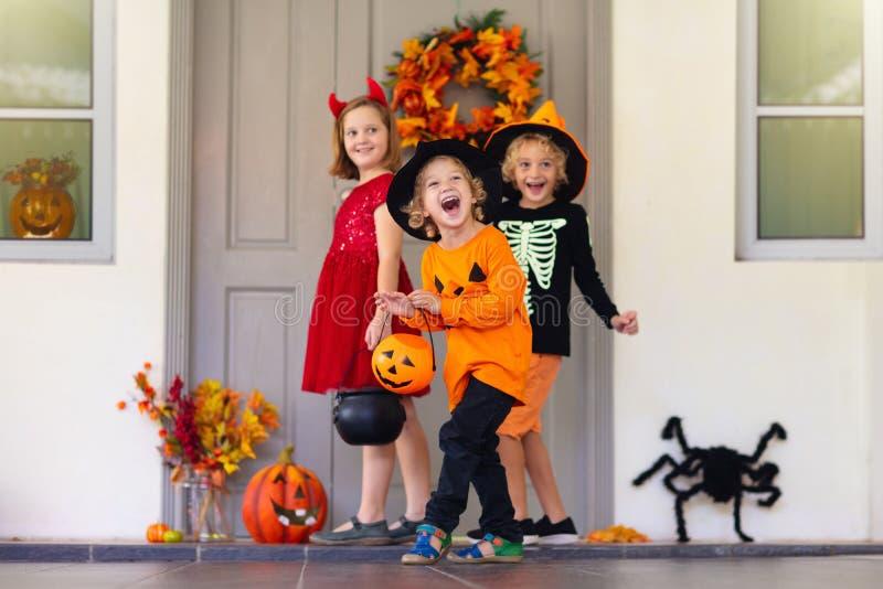 Kids trick or treat. Halloween fun for children stock photo