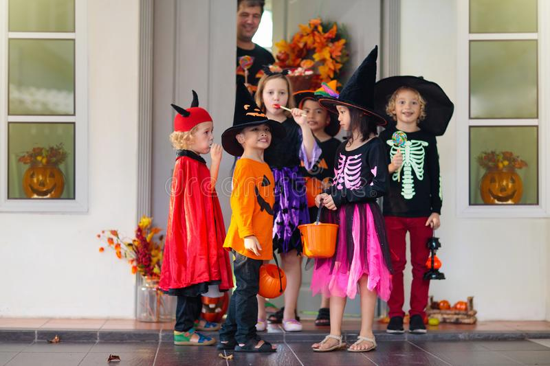 Kids trick or treat. Halloween. Child at door royalty free stock photo