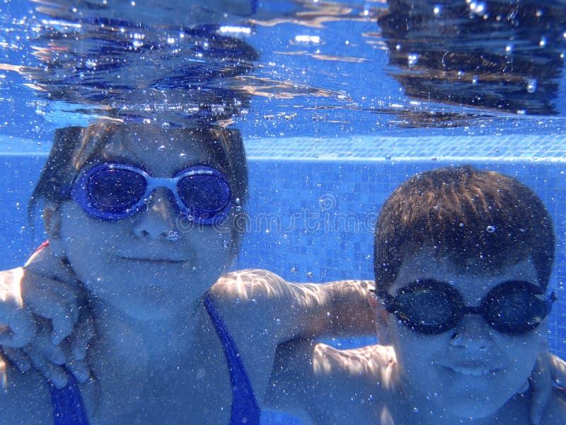 Kids underwater in the pool royalty free stock image