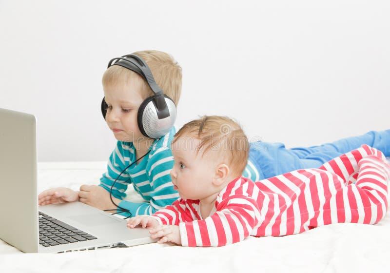 Kids using computer stock image