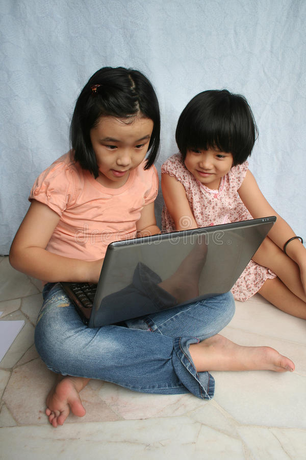 Download Kids using laptop stock image. Image of siblings, happiness - 12604759
