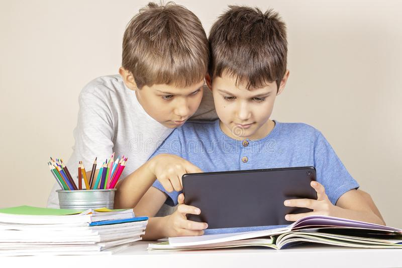 Kids using together tablet computer at home royalty free stock photography
