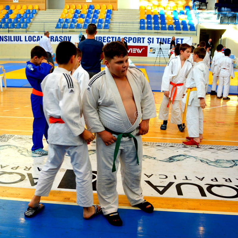 Kids waiting before the Kids Judo Cup 2016. The National contest Kids Judo Cup 2016 in Brasov stock photography