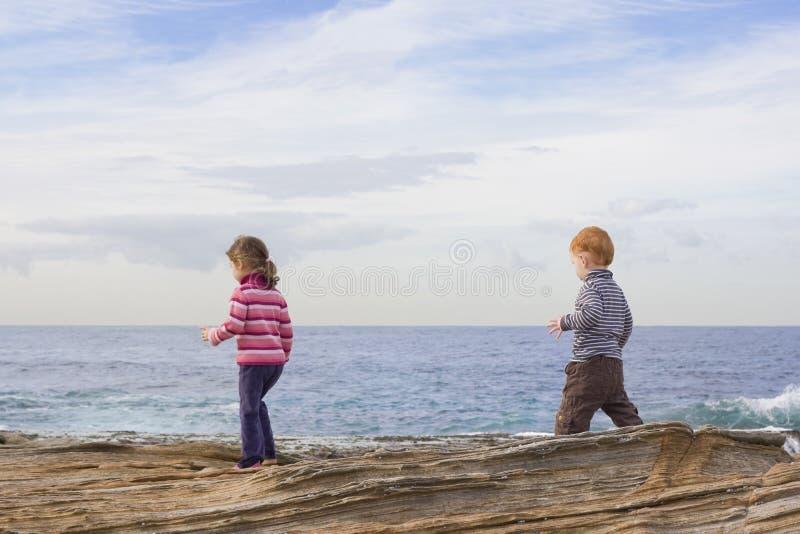 Download Kids Walking On Beach Rocks Stock Photo - Image: 10653890
