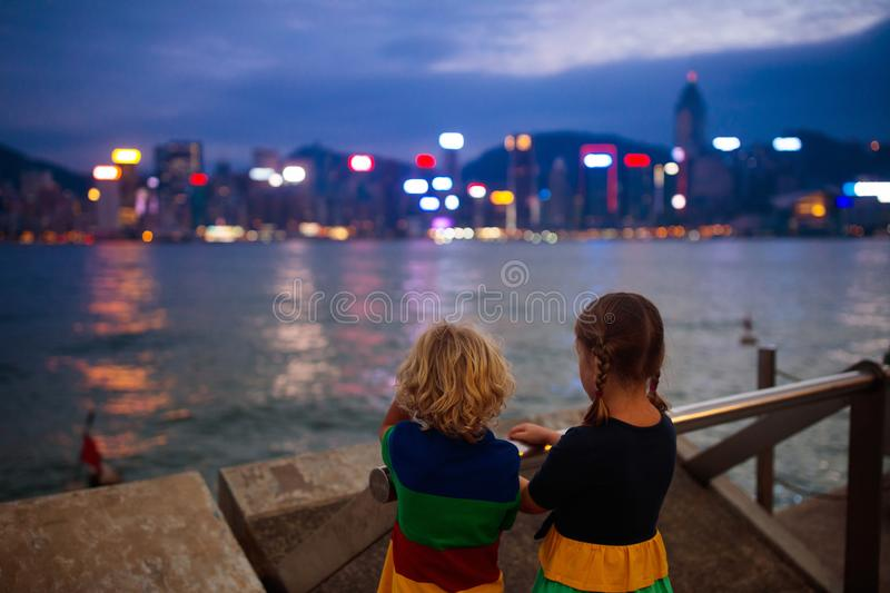 Kids watch Hong Kong harbor skyline royalty free stock photo