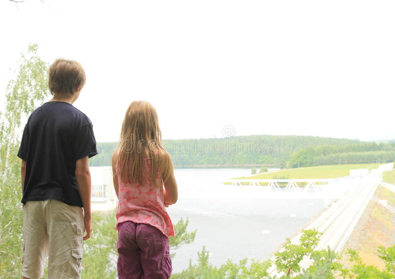 Kids watching a dam stock photos