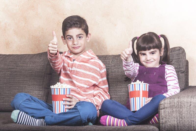 Kids watching TV royalty free stock photo
