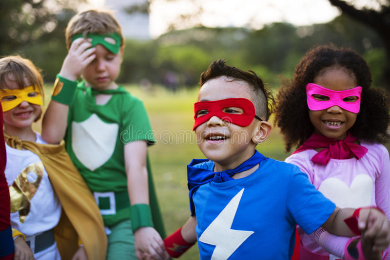 Kids Wear Superhero Costume Outdoors stock photos