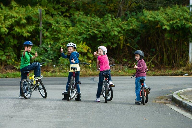 Kids wearing bicycle helmets stock images