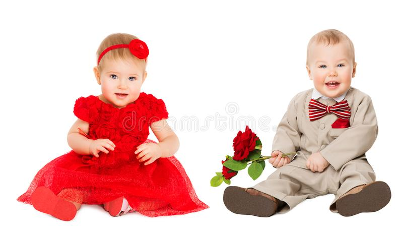 Kids Well Dressed, Elegant Baby Girl in Red Dress, Boy in Suit with Flower stock photo