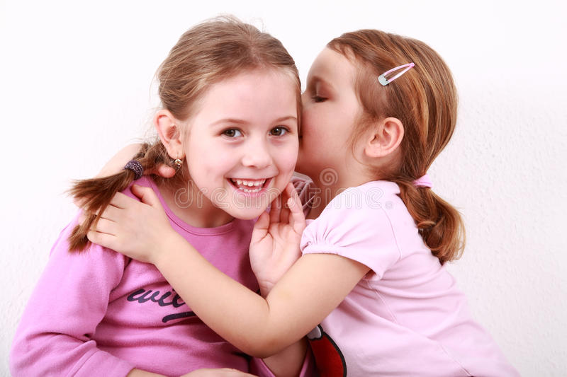 Kids whispering royalty free stock images