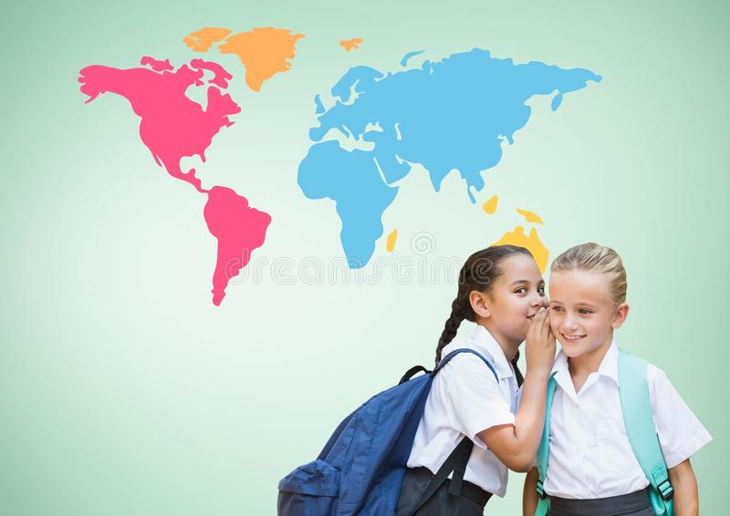 Kids whispering in front of colorful world map royalty free stock image