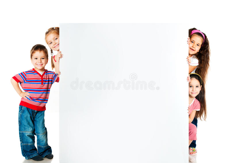 Kids beside a white blank. For text or image stock photo