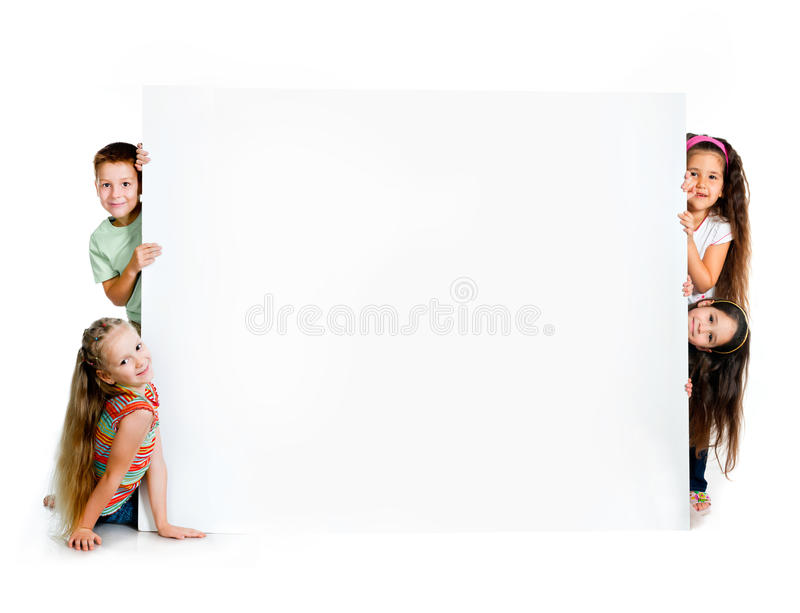 Girles beside a white blank royalty free stock photo