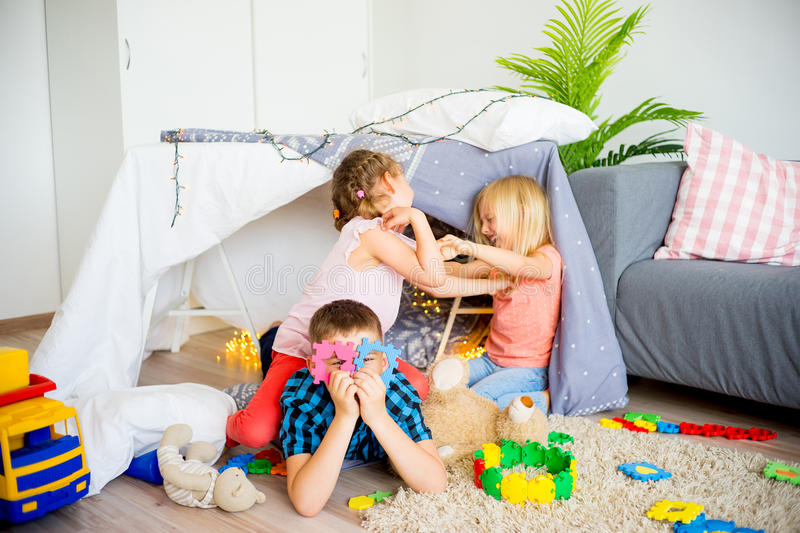 Kids in a wigwam royalty free stock photo