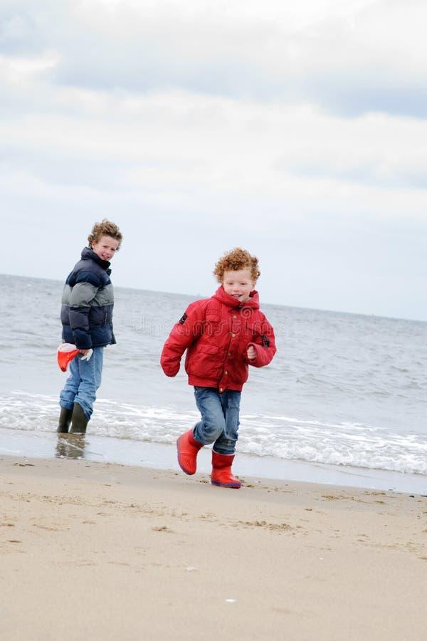 Kids At Winter Beach Stock Photos