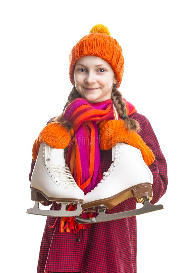 Kids Winter Sports.Portrait of Caucasian Girl in Winter Clothes Posing with Ice Skates Against Pure White Background. Vertical Image stock photos