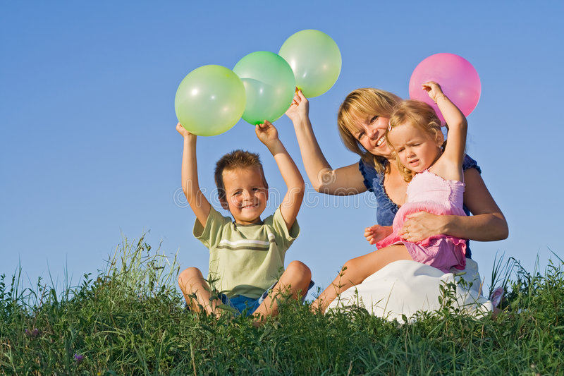 Download Kids And Woman With Balloons Outdoors Stock Photo - Image: 6193440