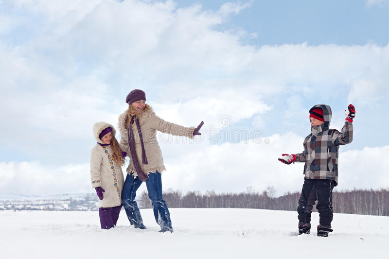 Kids and woman enjoy the snow stock photo
