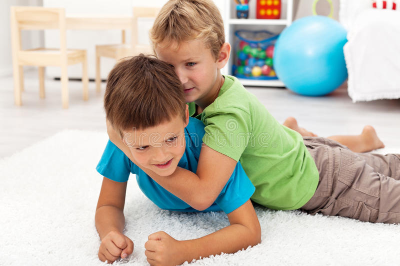 Kids Wrestling On The Floor Royalty Free Stock Photography