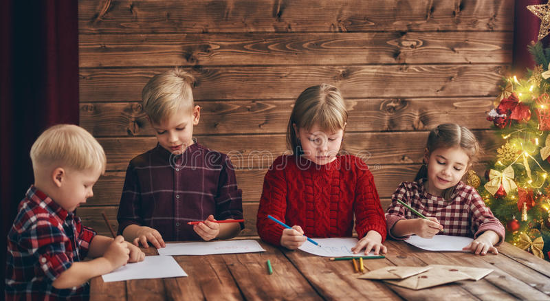 Kids writing letters to Santa Claus royalty free stock images