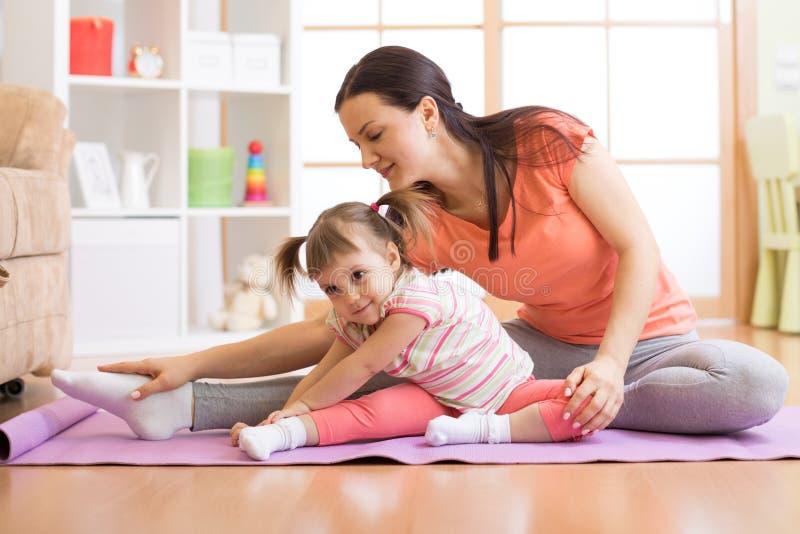 Kids yoga female teacher training child stock photos