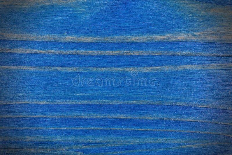 Kiefernholzhintergrund malte blau und mit Vignette lackiert stockfotografie