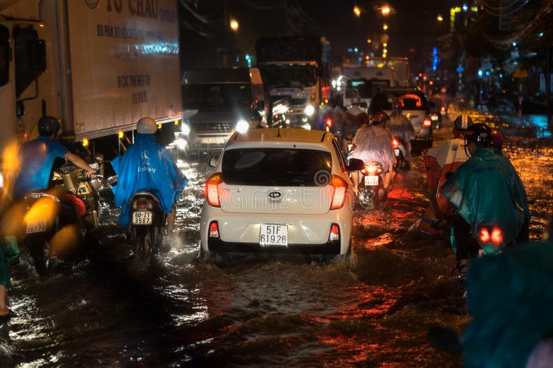 Kien Giang, Vietnam - Dec 6, 2016: Flooded street on Asian city after heavy rain at night in Rach Gia city, South Vietnam.  stock photos